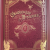 Candlekeep Mysteries alternate cover is a soft finish deepish red with gold lettering and accent art. It appears as you might dream a tome on the shelves of the famed library-keep might look. There are arcane symbols and guardian drakes.